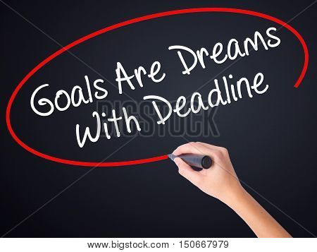 Woman Hand Writing Goals Are Dreams With Deadline With A Marker Over Transparent Board