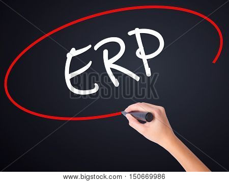 Woman Hand Writing  Erp (enterprise Resource Planning)   With A Marker Over Transparent Board