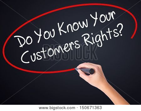Woman Hand Writing Do You Know Your Customers Rights? With A Marker Over Transparent Board .