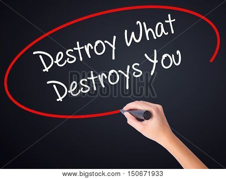 Woman Hand Writing Destroy What Destroys You With A Marker Over Transparent Board .
