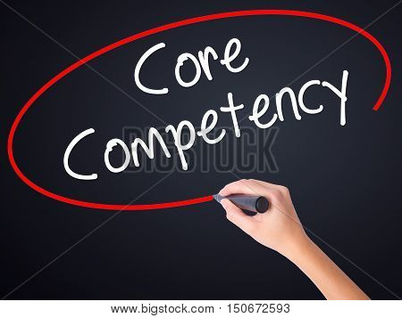 Woman Hand Writing Core Competency With A Marker Over Transparent Board