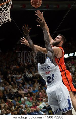 VALENCIA, SPAIN - OCTOBER 6th: Dubljevic with ball and Hunter during spanish league match between Valencia Basket and Real Madrid at Fonteta Stadium on October 6, 2016 in Valencia, Spain