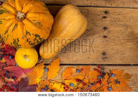 Helloween Pumpkins Over An Old Rustic Vintage Table - Top View, Copy Space