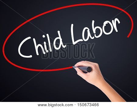 Woman Hand Writing Child Labor With A Marker Over Transparent Board