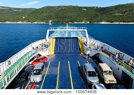 Prizna Croatia - July 17 2016: Ferry boat is leaving Porozina port on island Cres and heading towards Brestova port in Istria Croatia.