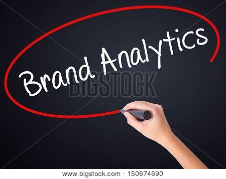Woman Hand Writing Brand Analytics With A Marker Over Transparent Board