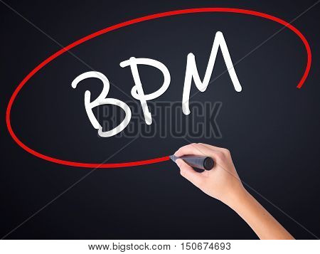 Woman Hand Writing  Bpm (business Process Management) With A Marker Over Transparent Board