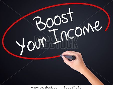 Woman Hand Writing Boost Your Income With A Marker Over Transparent Board