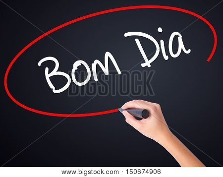 """Woman Hand Writing """"bom Dia"""" (in Portuguese - Good Morning)  With A Marker Over Transparen"""