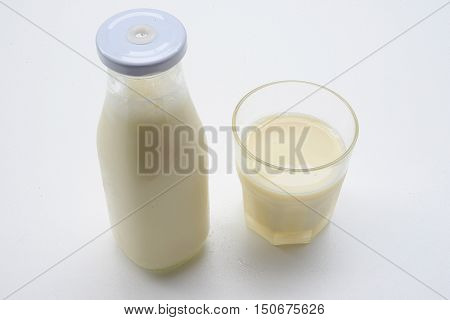 Soy milk in glass with soybeans. Food for health.