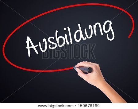 Woman Hand Writing Ausbildung (education In German) With A Marker Over Transparent Board
