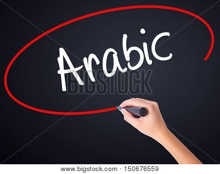 Woman Hand Writing Arabic  With A Marker Over Transparent Board
