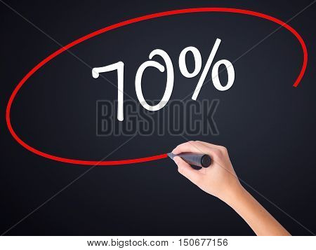 Woman Hand Writing 70% With A Marker Over Transparent Board