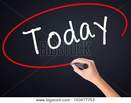 Woman Hand Writing Today With A Marker Over Transparent Board