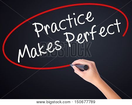 Woman Hand Writing Practice Makes Perfect With A Marker Over Transparent Board