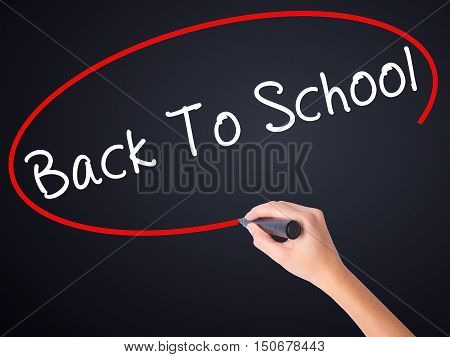 Woman Hand Writing Back To School With A Marker Over Transparent Board