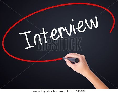 Woman Hand Writing Interview With A Marker Over Transparent Board