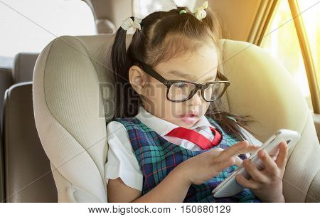 children using mobile smart phone in car