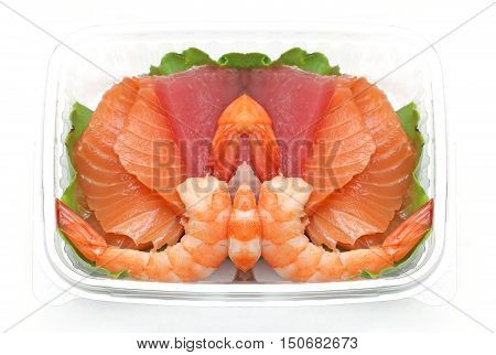 Assortment of fresh fish Japanese sashimi in plastic container