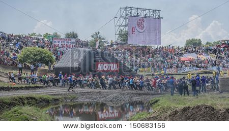 Rostov-on-Don Russia- June 05 2016: Tug of war with the people of the tractor on Bizon Track Show.Spectators watch the tug
