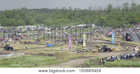 Rostov-on-Don Russia- June 052016: Competition for agricultural tractors on the BizonTrack Show. Viewers and engineering watch the race. Media photographs the race