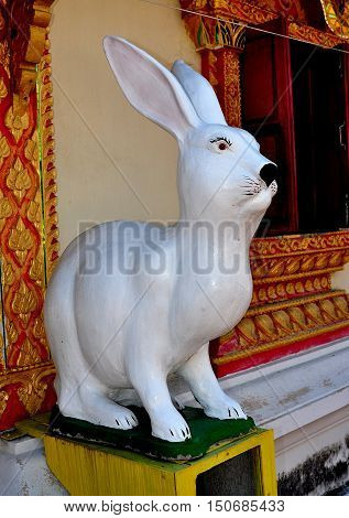Lamphun Thailand - December 28 2012: Carved figure of a giant white rabbit stands outside the Ubosot sanctuary hall at Wat Doi Ti