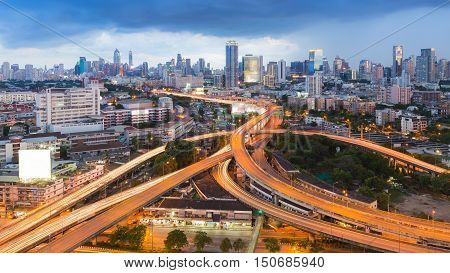 Bangkok city highway interchanged with office building background, Thailand, long exposure