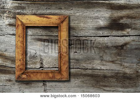 blank photo-frame on old wooden background
