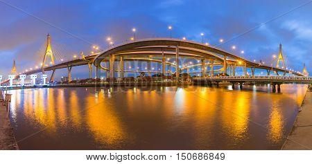 Twilight twin suspension bridge river front light night view. Bangkok Thiland