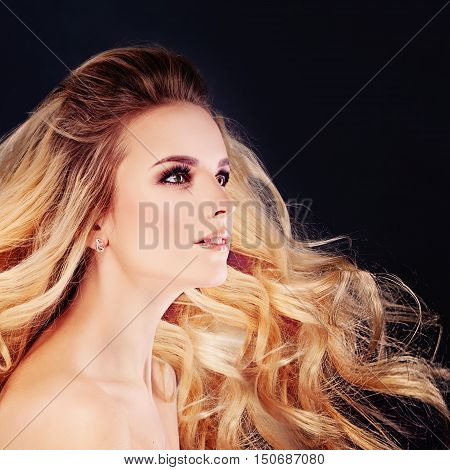 Cute Woman with Windy Hair. Blonde Curly Hairstyle