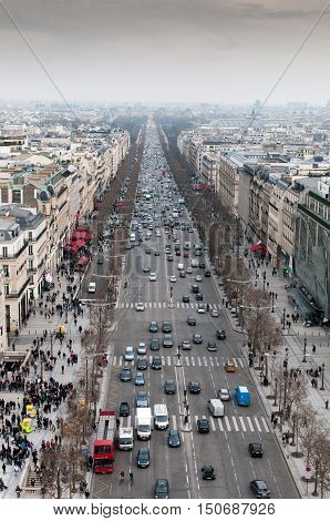Paris France - March 22 2013: Skyline of Paris city in france with people and cars on the Champs Elysees avenue from the top of Arc de Triomphe monument.