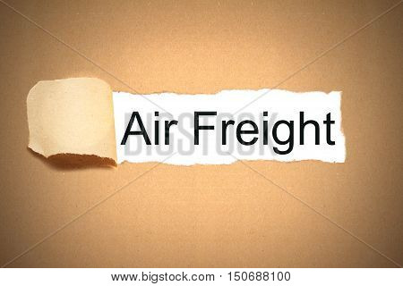 brown package paper carton torn to reveal white space air freight