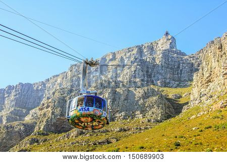 Cape Town, South Africa - January 11, 2014: the cable car's beams to the top of the famous Table Mountain National Park. Aerial Cableway popular tourist attraction in Cape Town in the blue sky.