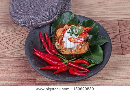 Streamed vegetable curry in banana leaf cup call