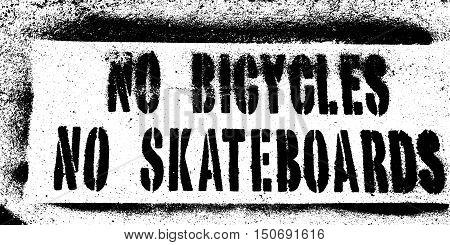 no bicycles no skateboards sidewalk stencil sign