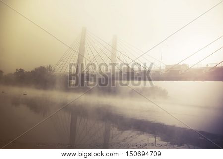transport truck on a highway with fog and sunrise