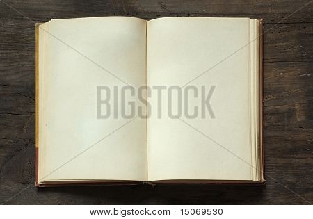 blank open book on old wooden background