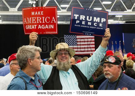Manheim PA - October 1 2016: An Amish man enthusiastically waves a Donald Trump campaign sign at a rally.