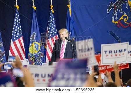 Manheim PA - October 1 2016: The oversized crowd waves signs as Donald J. Trump speaks at his campaign political rally Lancaster County.