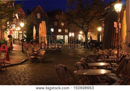 Street cafe at late autumn  near of the old hanse-harbor of Stade,  Lower Saxony, Germany