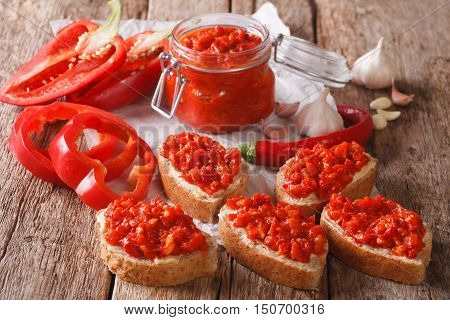 Traditional Balkan Ajvar From Peppers With Garlic Close-up. Horizontal