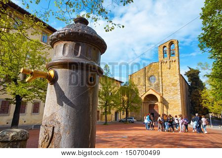 ITALY,AREZZO,ITALY-APRIL 18,2015:Ancient water tap in front of Duomo of San Domenico in Arezzo
