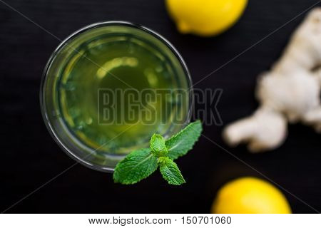 Fresh mint tea with lemons and ginger