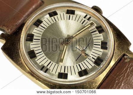 Old soviet analog watch close up isolated on white background