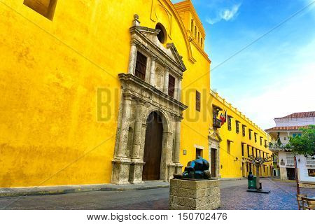CARTAGENA COLOMBIA - MAY 25: Santo Domingo church and plaza in Cartagena Colombia on May 25 2016. The statue in the plaza is Gertrudis by Fernando Botero
