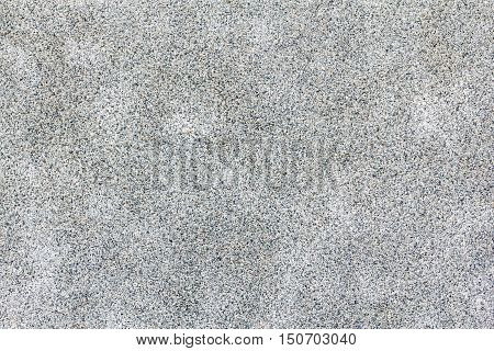 little grey pebbles surface with abstract stains. Seamless texture backgrounds