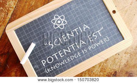 Scientia potentia est. Latin aphorism meaning Knowledge is power.