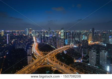 Large transport interchange in Shanghai city at summer night, view from K11 building