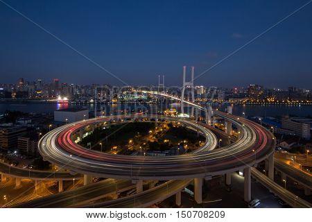 Huangpu Bridge and large transport interchange with illumination at dark night