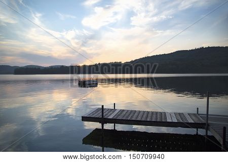 A dock and diving platform in Little Squam Lake New Hampshire at sunset